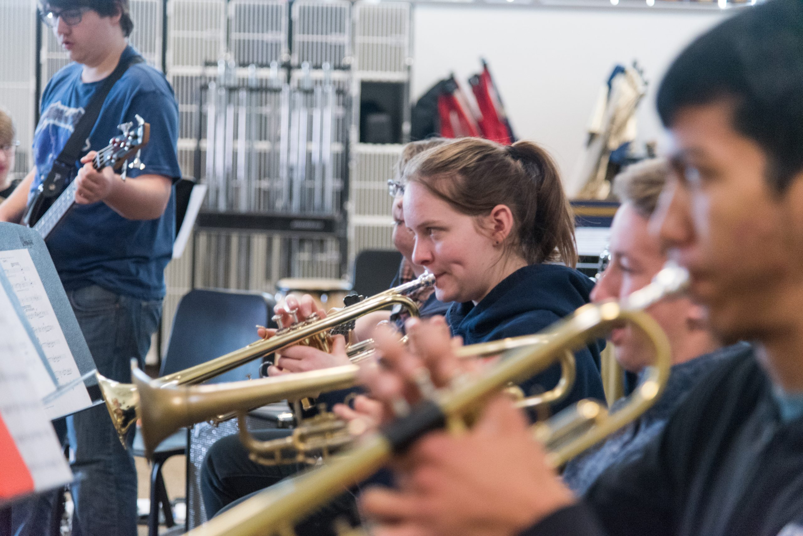 Students playing trumpet in a band